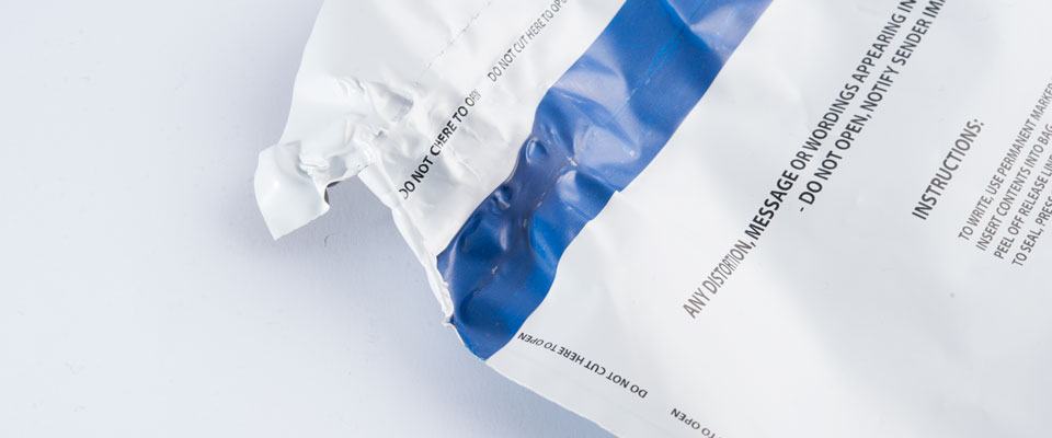 What makes the SCEC approved tamper evident bags extra secure is the aggressive adhesive that functions under extreme temperatures. When heated, the adhesive will continue to function and show void messages when forcibly removed. If enough heat is applied, the tape will warp and distort while the adhesive holds.
